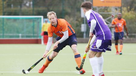 Jeff Parker looks for a pass in the match between St Albans and Saffron Walden men's first teams. Pi