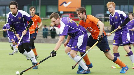 Saffron Walden dribble out of defence in the match between St Albans and Saffron Walden men's first