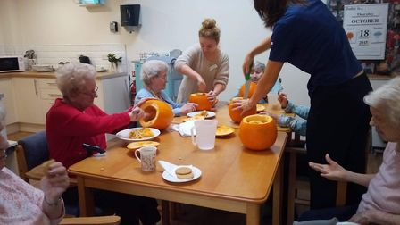 Tesco community champion Mandy Jinkerson with residents at Richard Cox House in Royston. Picture: Co