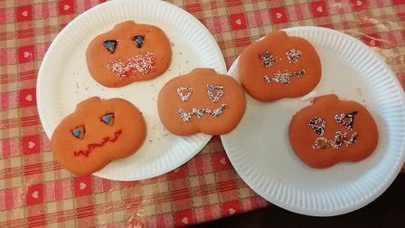 Tesco community champion Mandy Jinkerson decorated Halloween biscuits with residents at Maycroft car