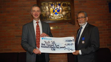 Youth Talk chief executive Trevor Fromant being handed the cheque by ex-mayor Mohammad Iqbal Zia.