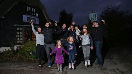 The Woodman owners Stuart and Jenna Johnson (centre) celebrate with family and staff. Picture: DANNY