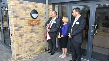 Chris May with his wife Janet and brother Nick unveiling memorial plaque