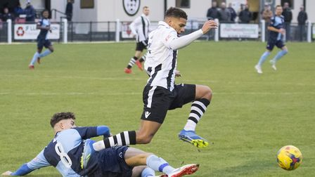 Matty Miles slides in to make a tackle during St Neots Town's draw at Coalville Town. Picture: CLAIR