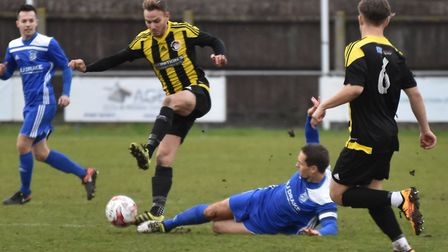 Captain Micky Hyem slides into a challenge as Godmanchester Rovers beat Holbeach in the FA Vase. Pic