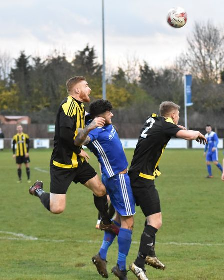 Godmanchester Rovers defender Charlie Bowen is sandwiched by Holbeach opponents. Picture: J BIGGS PH