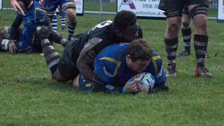 Josh Dear touches down for one of his two tries to help St Ives to victory at Stewart & Lloyds. Pict