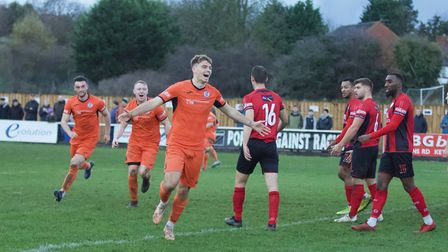 Sam Cartwright is all smiles after doubling the St Ives Town lead at Kettering Town. Picture: LOUISE