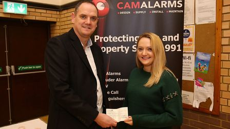 CamAlarms operations director Nick Lake presents a cheque which will provide six months worth of fun