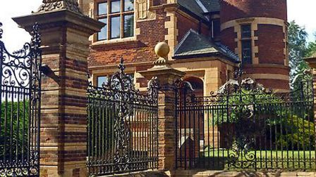 The entrance lodge, with its Scottish baronial style turret and wrought iron gates, was built in 189