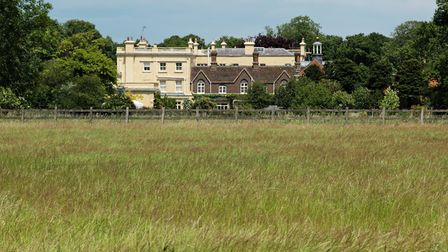 The imposing Childwickbury Manor, behind a terrace of smaller properties