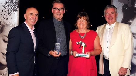ChipsAway St Albans' Brian and Amanda Palmer (middle two) receiving their franchisee of the year awa