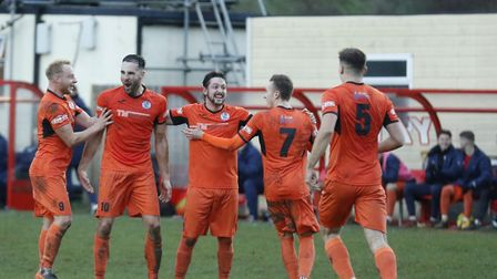 St Ives Town players celebrate Danny Kelly's free-kick strike during their superb victory at Ketteri