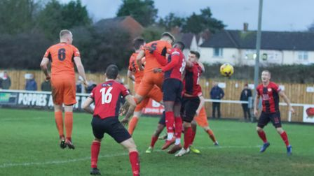 Sam Cartwright heads St Ives Town's second goal in their triumph at table-topping Kettering Town. Pi