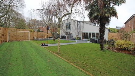 The rear garden is mainly laid to lawn, with a natural stone patio area, newly built landscaped pond