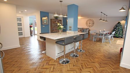 The large open plan dining/living area features parquet-style karndean flooring and underfloor heati