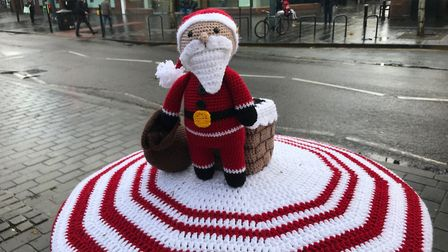 Knitted pillar box topper in St Albans.
