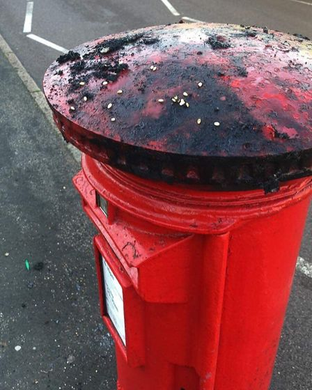 The torched knitted pillar box topper in Sun Lane, Harpenden.
