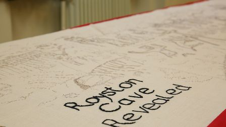 The Royston tapestry is unveiled and checked before preparations for it to go on display commence. P