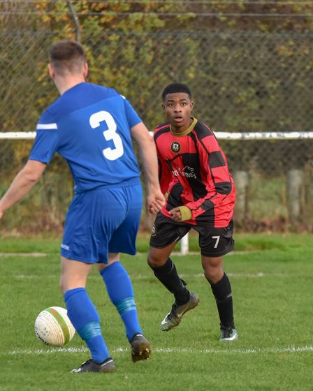 Keith Mureza on the ball for Huntingdon Town against Rushden & Higham. Picture: J BIGGS PHOTOGRAPHY