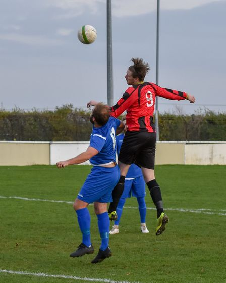 Jamie Waterworth gets in a header as Huntingdon Town lost to Rushden & Higham. Picture: J BIGGS PHOT