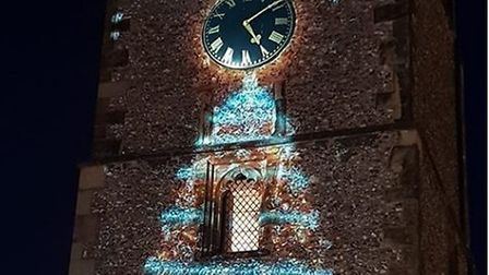 The Clock Tower projection on the evening of the St Albans Christmas lights switch on. Picture: BID.