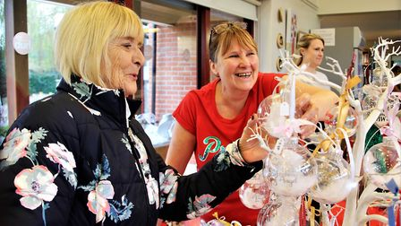 Julie Emmerson helping Eva Ingreburg, left, to choose from her selection of Christmas baubles. Pict