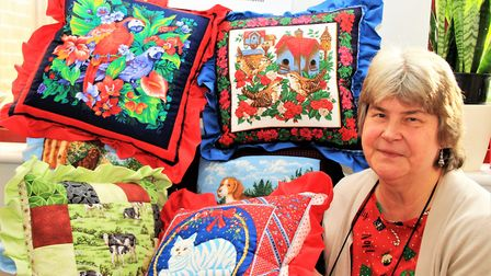These vibrant cushions are made by Christine Pickford, with a proportion of the proceeds being donat