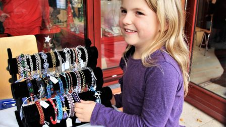 Youngster Natalie Youdam excited with her find on the stall of jewellery designer Lorraine Chapman.