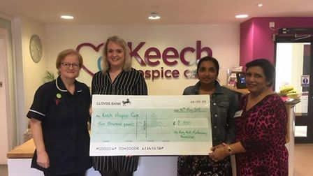 Anna-Ruby giving a cheque from The Harry-Krish Mootoosamy Foundation. Picture: Anna-Ruby Yates