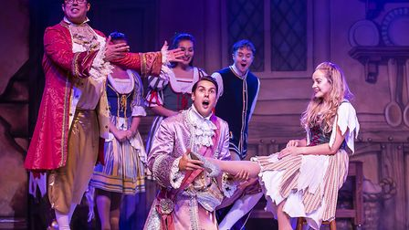 It fits! Prince Charming tries on the slipper on Cinders' foot in pantomime Cinderella at The Alban