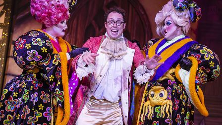 Dandini (Bob Golding) with the Ugly sisters in pantomime Cinderella at The Alban Arena in St Albans.