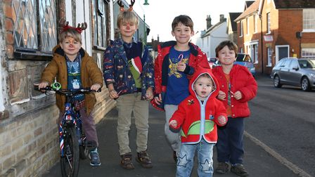 The Haddock and Lloyd-Fox families enjoy the candy cane trail at Ashwell at Christmas. Picture: DANN