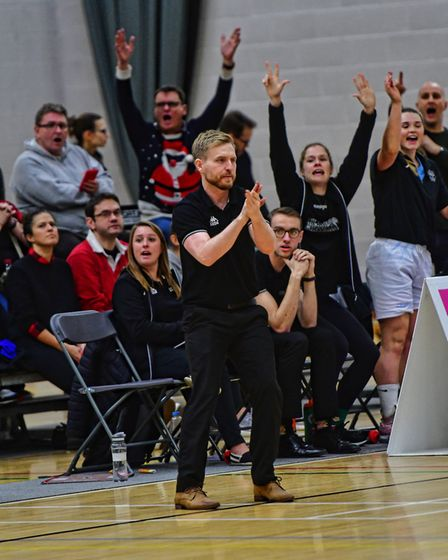 Head coach Lee Ryan shows his approval as the home crowd roars Oaklands Wolves to victory over Essex