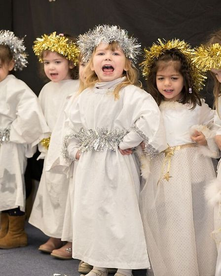 The children of Little Robins Pre-School performing 'Toby's Christmas Drum' for the audience from th