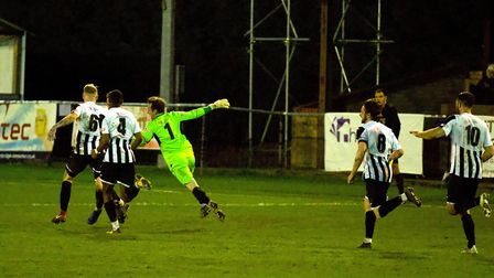 Goalkeeper Martin Conway joins in the celebrations following St Ives Town's last-gasp winning goal a