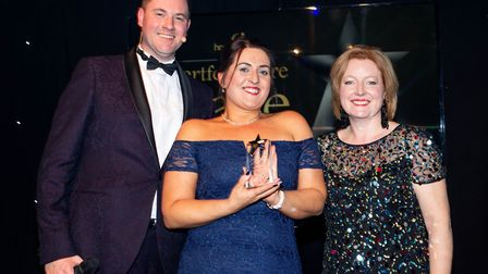 Lea-Ann Smith, centre, with her care award. Picture: HCPA