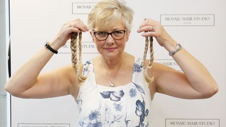 Janice Cook had her hair cut off for the Little Princess Trust at Mosaic Hair Studio. Picture: DANNY