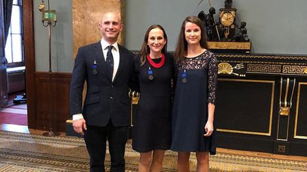 Lizzie Bryan, flanked by brother-in-law Peter Bryan and Nicola Purchase who all received Royal Human
