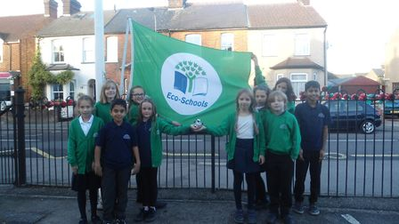 The members of the Eco Committee with the Green Flag. Members are from Years 3,4 and 5, and aged bet