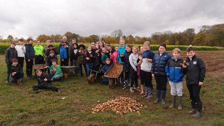 RSAT pupils showing off the fruits of their harvest at Church Farm. Picture: RSAT