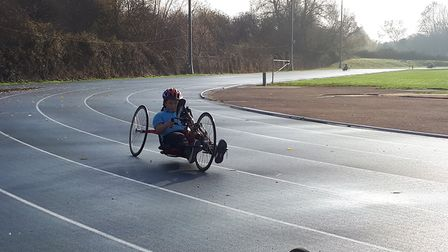 Giles on a handcycle at the British Cycling Disability Hub Sessions at Stoke Mandeville Hospital. Pi