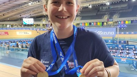 Poppy Shipley shows off her gold medals at the British Indoor Rowing Championships.