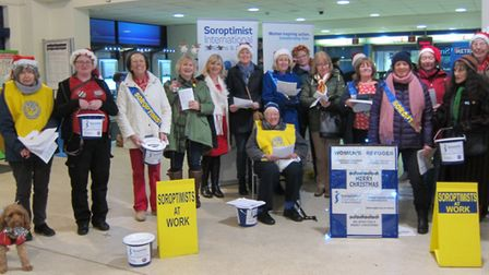 Carol singers from the Soroptimists at St Albans City station.