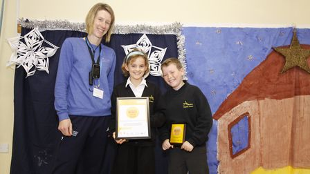 Steeple Morden Primary School pupils being awarded gold award from Claire McDonnell. Picture: Steepl