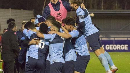 St Neots Town players celebrate a goal with boss Matt Clements during their victory against Redditch