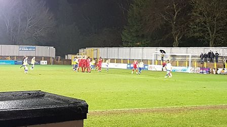 St Albans City's David Noble curls a free-kick into the net against Hertford Town.