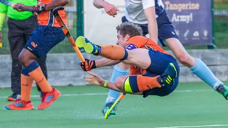 St Albans' Matt Davey goes airborne against West Herts. Picture: CHRIS HOBSON PHOTOGRAPHY