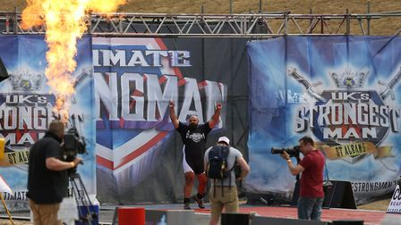2017 champion Laurence Shahlaei introduced to the crowd at the UK's Strongest Man event held in West