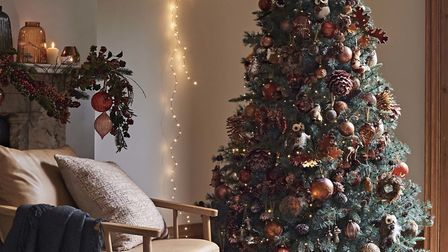 Conjure A Copper Glow: Amber Highland Pine Unlit Christmas tree, 7 ft, £199; Autumn Berry Garland, £